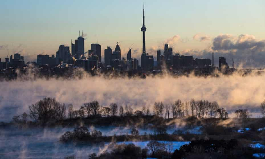 Mist rises from Lake Ontario in front of the Toronto skyline during extreme cold weather in February 2016.