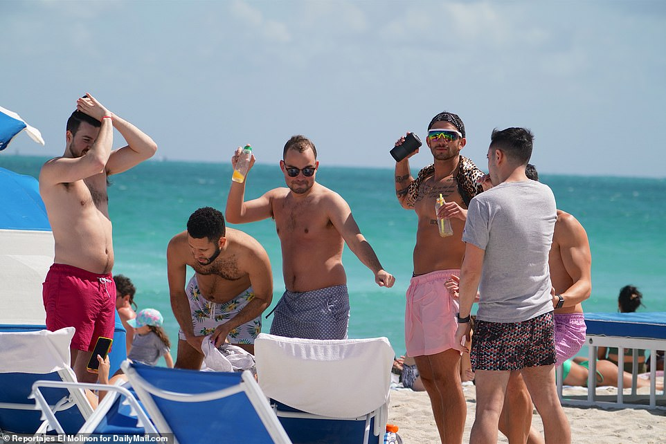 Thousands of young college students are crowding bars and beaches in Florida for spring breaks, raising alarm among health experts