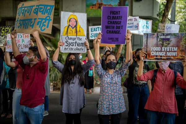 A climate change protest in New Delhi last week. Among the invitees are the leaders of all the United States' major European and Asian allies, along with Prime Minister Narendra Modi of India.