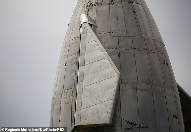 The Starship is constructed of stainless steel, which stands 160 feet tall, and is fitted with a nose cone and flaps at the side