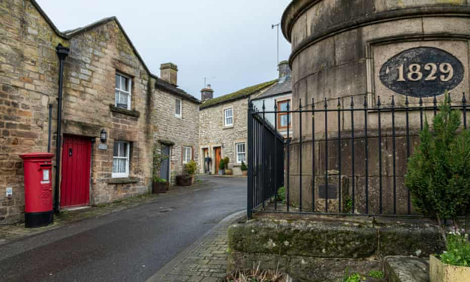 The Victorian water tank and tiny cottages in Youlgrave, Peak District National Park
