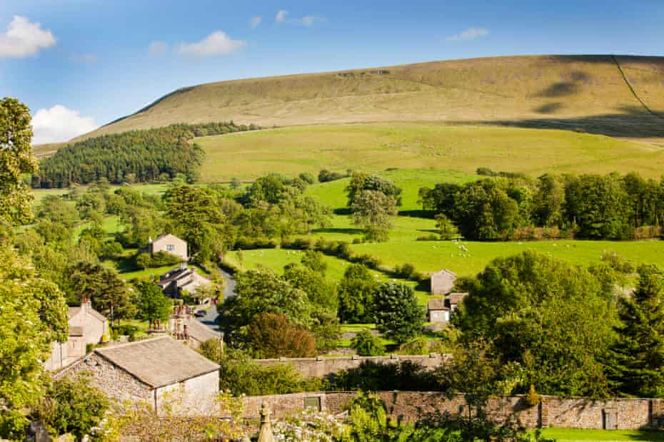 The village of Downham, nestling beneath Pendle Hill in the Ribble Valley, Lancashire, UK.