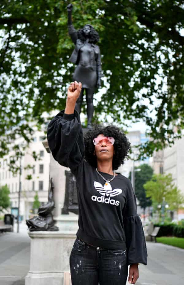 BLM protester Jen Reed. A statue of her in this pose temporarily stood on Colston's plinth.