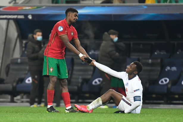 Eddie Nketiah of England looks dejected as he helped up by Thierry Correia of Portugal