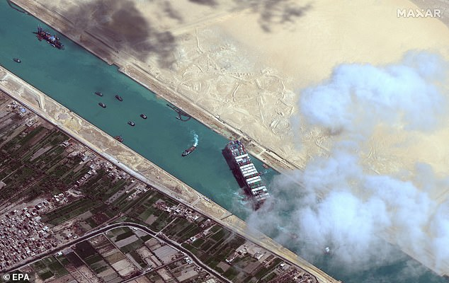 Pictured is a satellite image showingthe Ever Given container ship after it has been moved away from the eastern bank of the canal and tugboats trying to reposition the ship, in the Suez Canal. It was blocking the canal for days before being moved