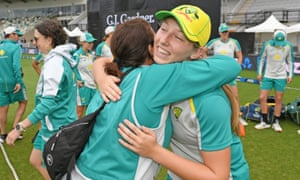 Darcie Brown of Australia is congratulated after being presented with her cap.