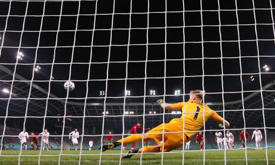Portugal's Francisco Trincaosends Aaron Ramsdale the wrong way from the penalty spot to score his side's second goal of the 2-0 win.