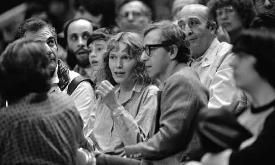 Woody Allen and Mia Farrow at a Philadelphia 76ers and New York Knicks game in New York in 1983.