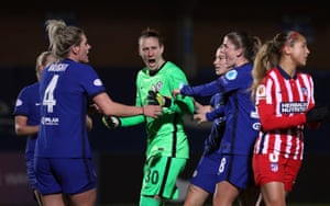 Chelsea keeper Ann-Katrin Berger celebrates with team mates after saving the penalty of Atletico's Deyna Castellanos.