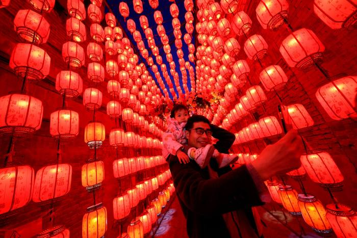A man takes photos during the Lantern Festival, marking the end of lunar new year celebrations last week, in Taiyuan, northern China