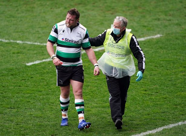 Jon Welsh leaves the pitch with a dislocated shoulder after the controversial early incident
