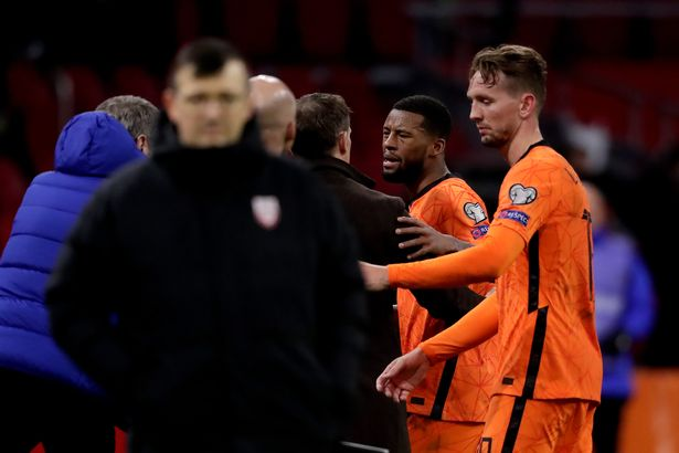 Georginio Wijnaldum exchanged words with Frank de Boer as he was hauled off late in the game
