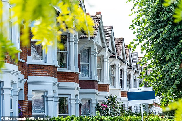 Slight slip:The cost of a home fell last month amid a 'softening' of demand ahead of the original end of the stamp duty holiday, Nationwide said