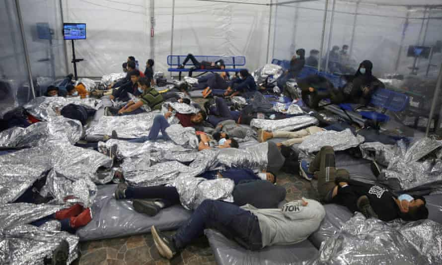 Migrants at the main detention center for unaccompanied children in Donna, Texas, on 30 March.