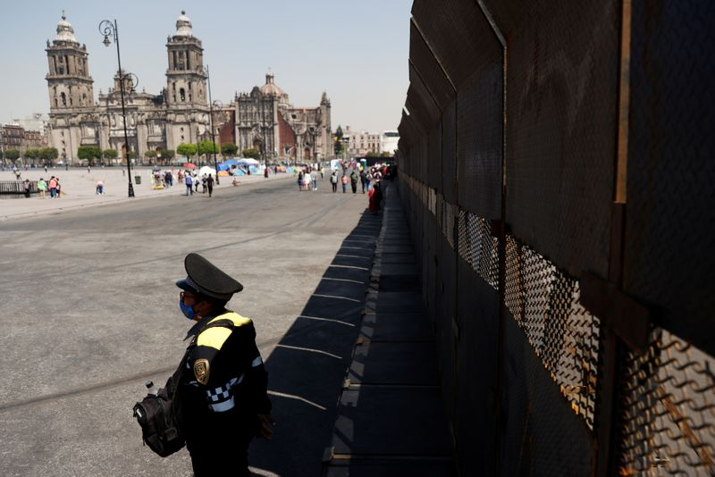 Mexican president defends 10-foot barriers to wall off women protesters