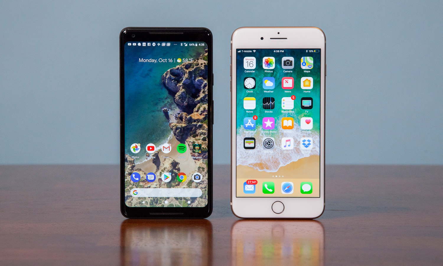 A Google Pixel 2 and an Apple iPhone 8 side-by-side.