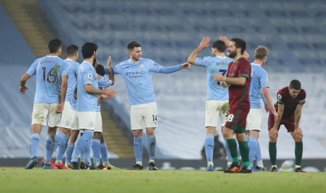 Manchester City players celebrate during their win over Wolves in the Premier League