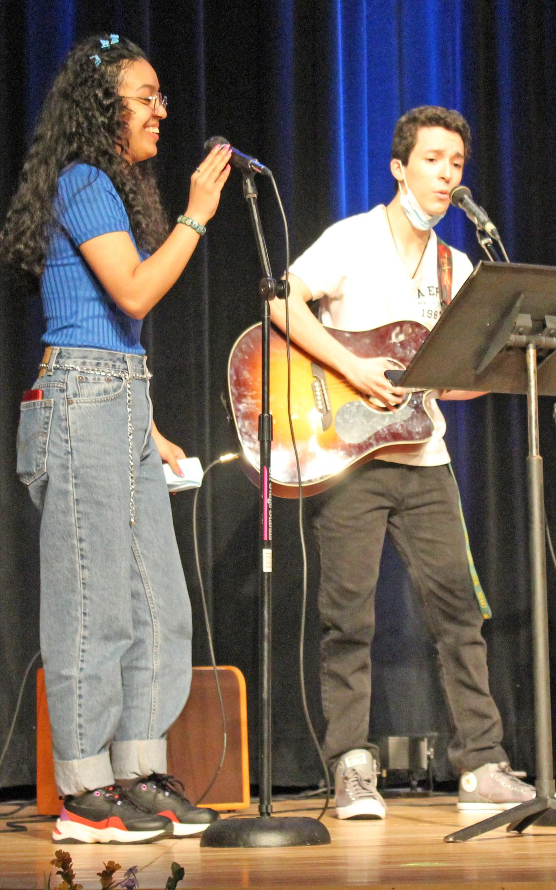 Siblings Evelyn and Alan Guajardo sing a duet during the Spring Fling coronation ceremony. (Robin Fish/Enterprise, March 29, 2021)