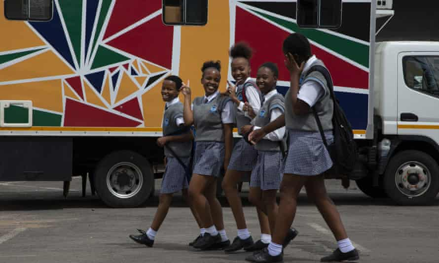 Schoolgirls pass a mobile reproductive health clinic in Soshanguve township, near Pretoria, South Africa. Such outreach projects will be irretrievably harmed by the aid cuts, experts say.