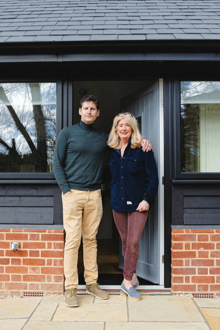 Butler and his wife Jane in front of the finished house