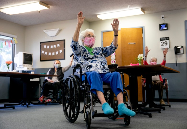 Betty Carter, center, participates in group exercise during an activity period with others from her cohort at Lincoln Glen Skilled Nursing Facility in San Jose on March 29, 2021. Photo by Anne Wernikoff, CalMatters