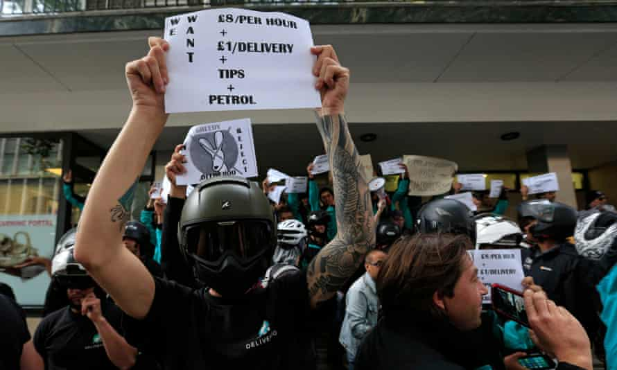 Deliveroo riders protesting over pay outside the company HQ in London.