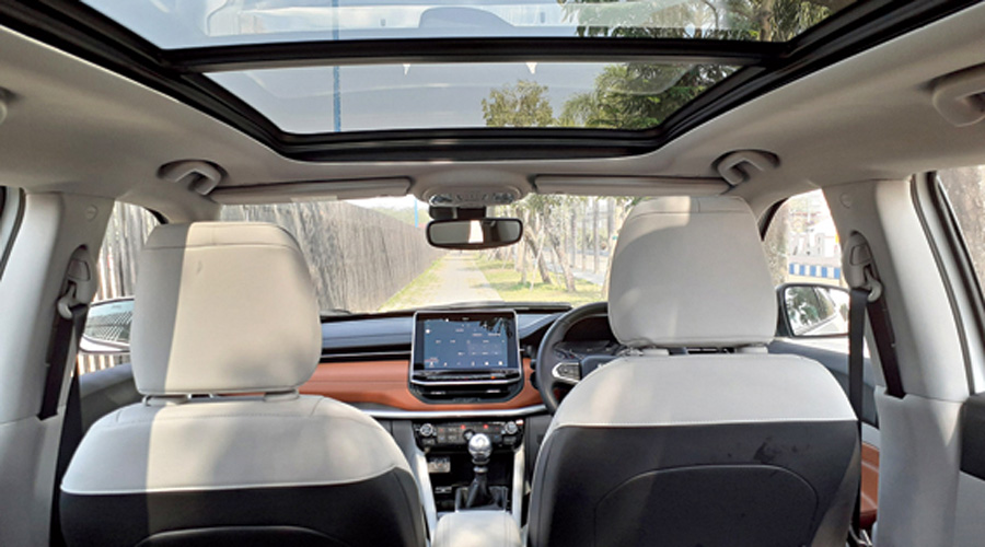 The two-tone cabin with the light upholstery is airy, but can get hot with the large sunroof open.