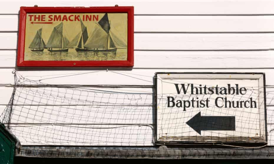 Signs for The Smack Inn and Baptist Church on a building in Whitstable, Kent.