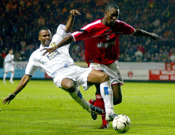Leeds United's Lucas Radebe (L) in action back in 2003