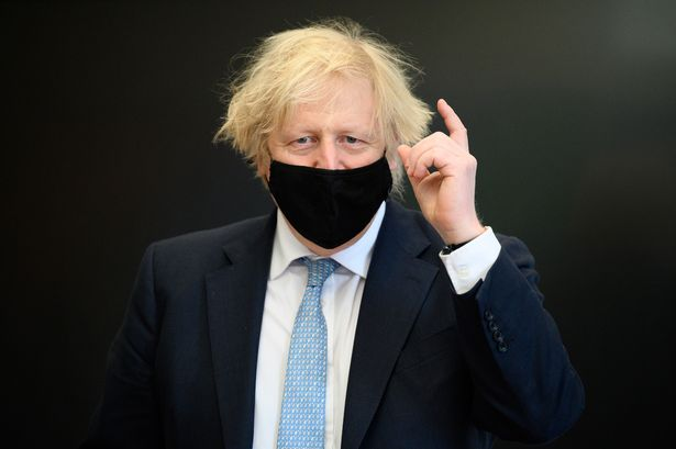 Boris Johnson wears a face mask at a school in Uxbridge