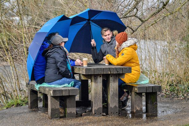 People chat over a coffee in Bute Park in Cardiff