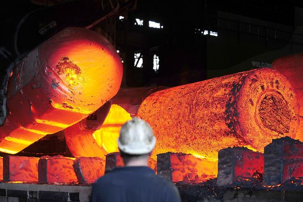 Red hot metal is moved across the heavy forge at the Forgemasters Works