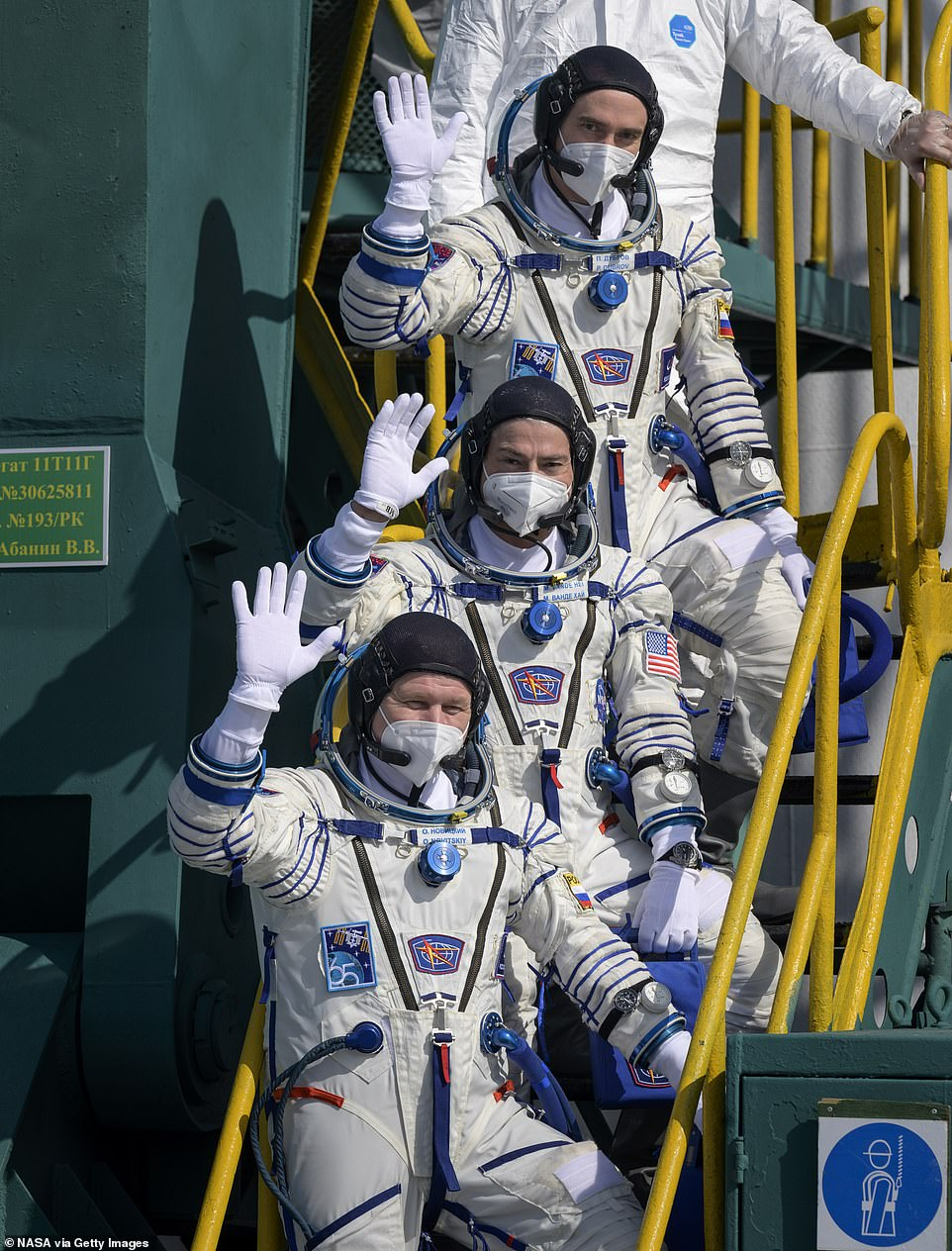 Expedition 65 Russian cosmonaut Oleg Novitskiy, NASA astronaut Mark Vande Hei and Russian cosmonaut Pyotr Dubrov wave farewell prior to boarding the Soyuz MS-18 spacecraft for launch at the Baikonur Cosmodrome on April 9 in Kazakhstan. The Soyuz MS-18 spacecraft will send the trio on a mission to the ISS