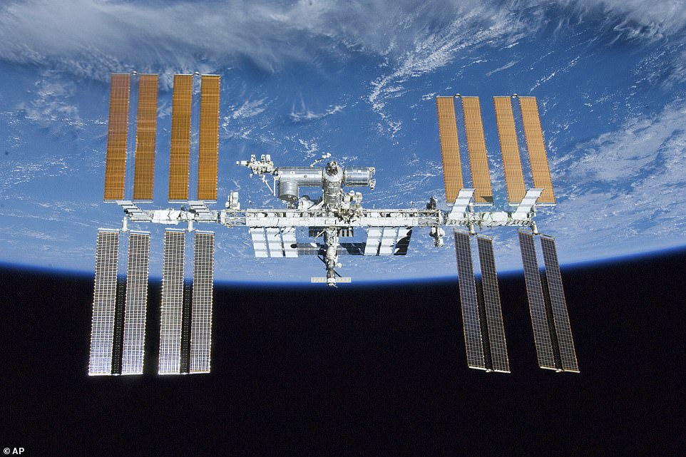 The International Space Station (ISS, pictured) is a $100 billion (£80 billion) science and engineering laboratory that orbits 250 miles (400 km) above Earth