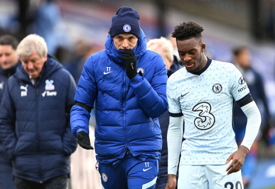 Thomas Tuchel, Manager of Chelsea interacts with Callum Hudson-Odoi of Chelsea  during the Premier League match between Crystal Palace and Chelsea at Selhurst Park on April 10, 2021 in London, England. Sporting stadiums around the UK remain under strict restrictions due to the Coronavirus Pandemic as Government social distancing laws prohibit fans inside venues resulting in games being played behind closed doors.