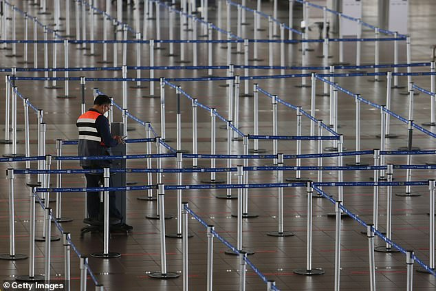 Almost empty lines at check-in points during the border closure at Arturo Merino Benitez International Airport in Santiago, Chile, on April 5