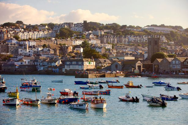 Boats in the harbour in St Ives, Cornwall at dusk