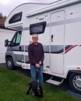 Rob Newton and his dog Baxter in front of the family's motorhome in Tyne and Wear.
