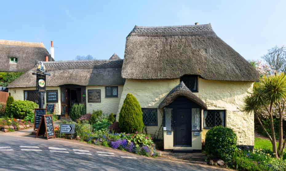 Quaint thatched pub at Maidencombe Beach in South Devon.
