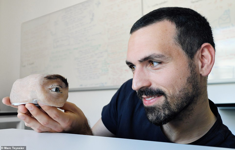 Eyecam is a research project developed and built by Marc Teyssier (pictured holding the device).This research was conducted during his time at Saarland University Human-Computer Interaction Lab