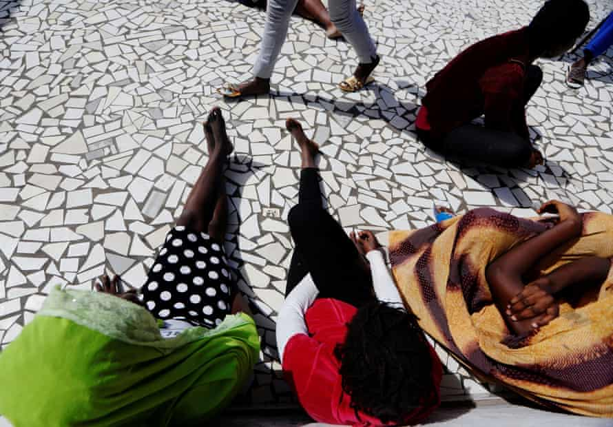 A young woman who said she was raped by her friend sits with others at La Maison Rose, Dakar, Senegal
