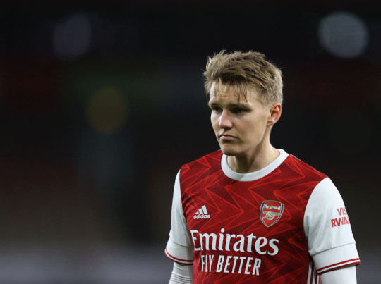 Martin Odegaard of Arsenal looks on during the Premier League match between Arsenal and Liverpool at Emirates Stadium on April 03, 2021 in London, England. Sporting stadiums around the UK remain under strict restrictions due to the Coronavirus Pandemic as Government social distancing laws prohibit fans inside venues resulting in games being played behind closed doors.