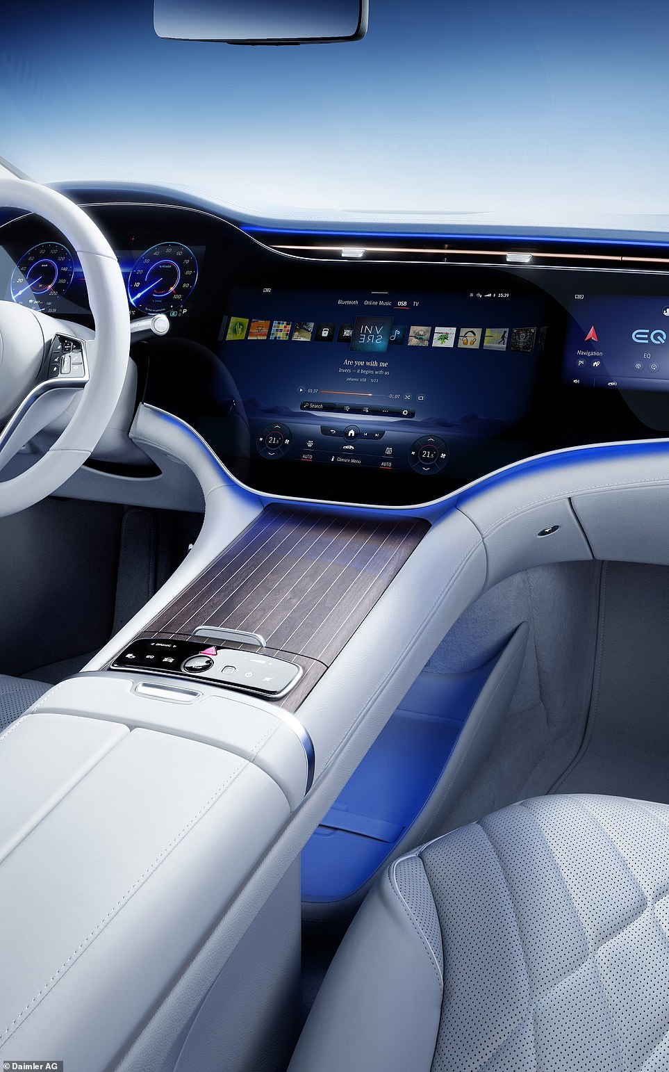 The section behind the steering wheel provides the driver's instrument cluster while the largest part of the display is for infotainment functions
