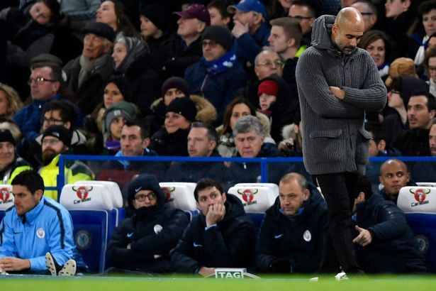 Guardiola pictured on the Stamford Bridge touchline in 2018