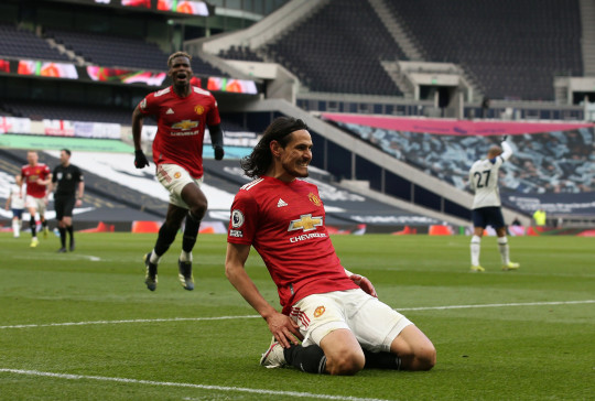 LONDON, ENGLAND - APRIL 11: Edinson Cavani of Manchester United celebrates scoring their second goal during the Premier League match between Tottenham Hotspur and Manchester United at Tottenham Hotspur Stadium on April 11, 2021 in London, England. Sporting stadiums around the UK remain under strict restrictions due to the Coronavirus Pandemic as Government social distancing laws prohibit fans inside venues resulting in games being played behind closed doors. (Photo by Matthew Peters/Manchester United via Getty Images)