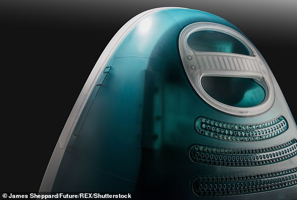 Image of the back of a vintage Apple iMac G3 home computer with a 'Bondi Blue' finish
