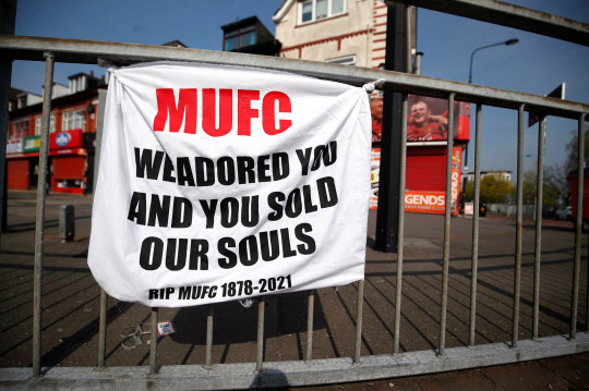 A banner left by Manchester United fans objecting to the clubs decision to join the European Super League, Sir Matt Busby Way, Manchester
