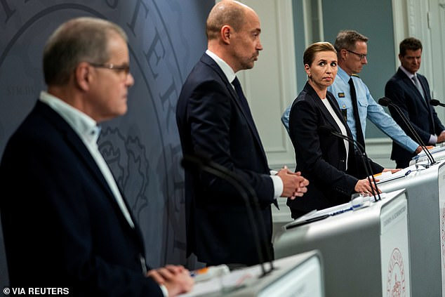 Pictured: Denmark's Prime Minister Mette Frederiksen (centre) looks at Health Minister Magnus Heunicke (second-left) during a coronavirus news conference last year. Heunicke has announced Denmark is looking to swap its unwanted AstraZeneca jabs for other coronavirus vaccines owned by other countries after ditching it entirely over blood clot fears