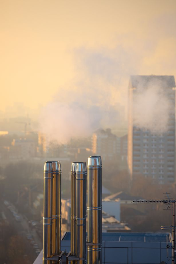 Pipes and steam against of city view. London