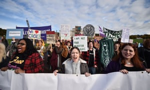 Demonstrators march through the streets of Belfast ahead of a meeting of the Stormont Assembly on abortion rights.